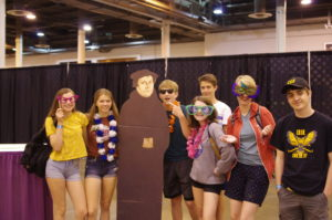 Teens standing with a cutout