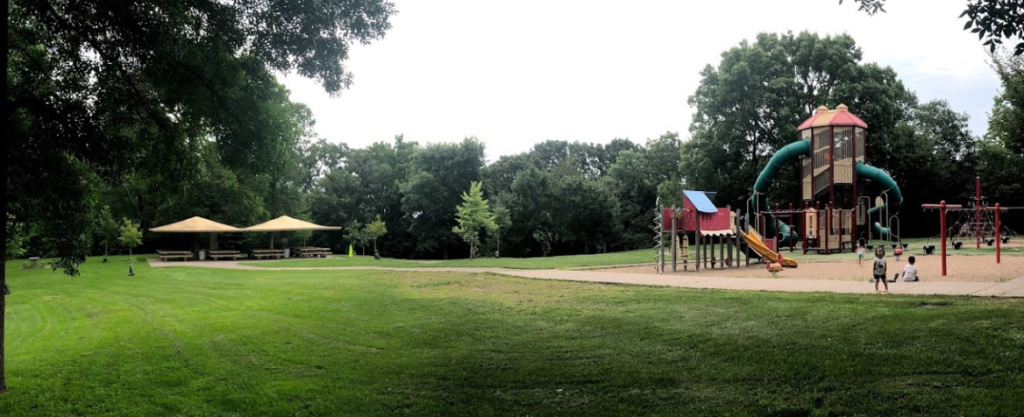 Park playground with shelter in background